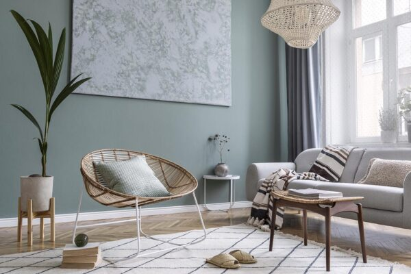 Bohointerior design of living room with sofa and rattan armcha